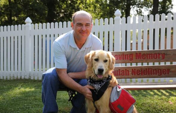 Golden retriever Snuggles His Owner's Seizures Away