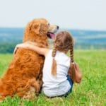 Child and a dog in order to find out what the best dogs for kids are