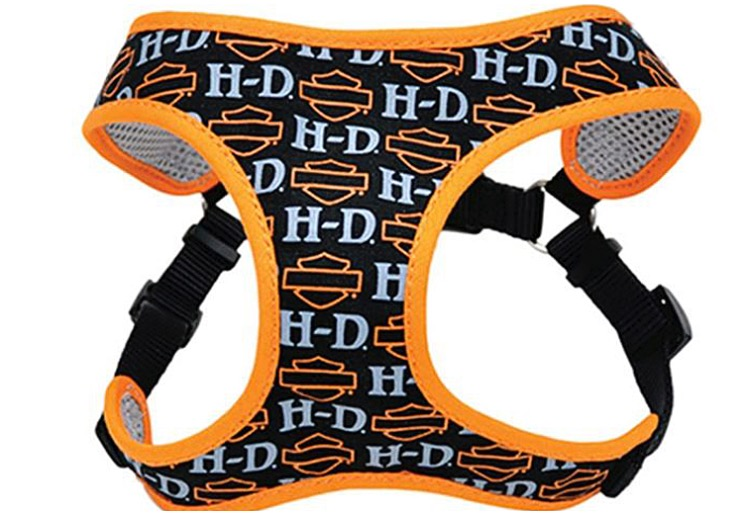 A harness for dogs in black, white and orange